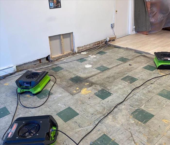 Drying the floors after water leak.
