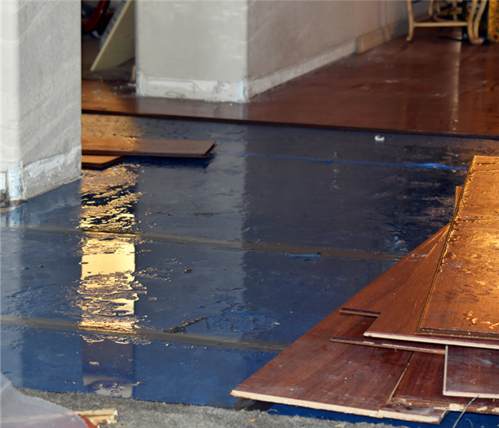 water covering floorboards